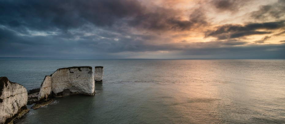 Beautiful sunrise panorama landscape over Old Harry Rocks in Dorset England